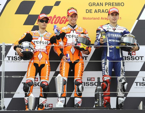 Honda MotoGP rider Stoner of Australia celebrates his win on the podium with his team mate Pedrosa of Spain and Yamaha MotoGP rider Lorenzo of Spain during the Aragon Grand Prix at Motorland racetrack in Alcaniz, near Zaragoza